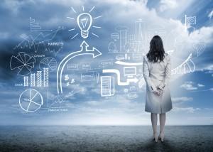 Businesswoman standing looking at marketing flowchart